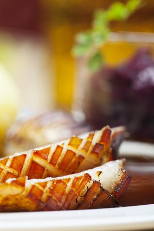 bavarian roasted pork on a plate photo