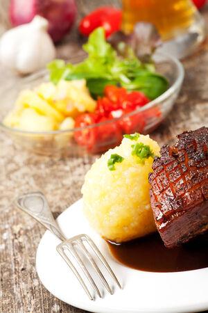 closeup of a bavarian roast pork dish photo