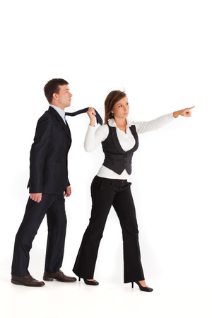 woman dragging a man in a suit