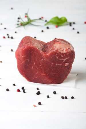 loin: raw piece of beef loin on wood Stock Photo