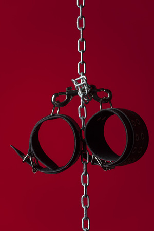 leather cuffs on a chain Stock Photo - 36633477