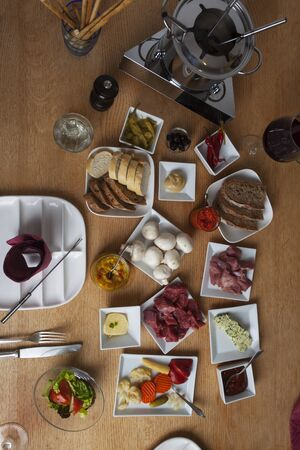 bird's eye view: fondue on a table seen from the top