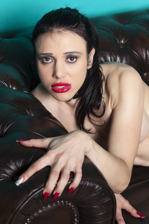 nude female body model: naked woman on a couch Stock Photo