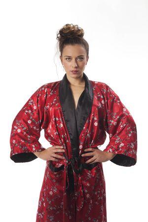 red bathrobe: slim woman in a kimono on white Stock Photo