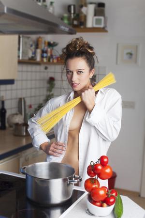Woman in a shirt cooking spaghetti