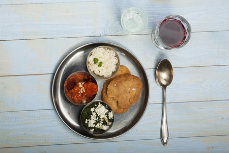 mixed indian thali food with rice photo