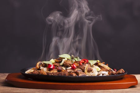 delicious food: steaming chicken sizzler with noodles