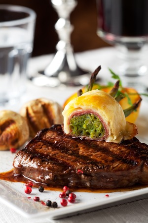 grilled potato: steak with grilled potato on a plate Stock Photo