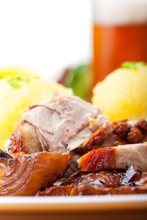 grilled bavarian pork meat with dumplings photo