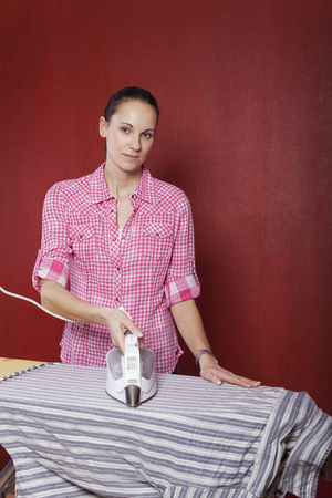woman ironing: young woman ironing