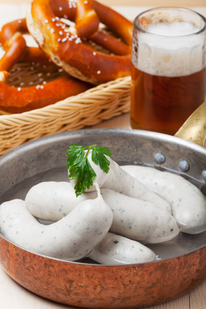 weisswurst: bavarian white sausages with pretzel