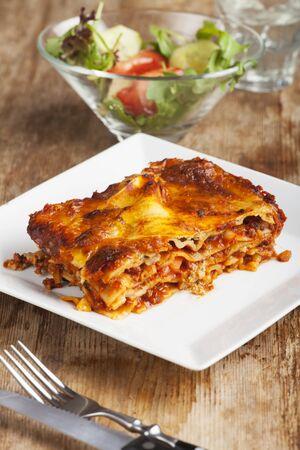 rustic  wood: homemade lasagna on rustic wood