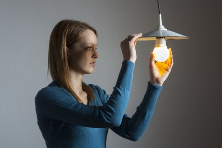 led lamp: young woman with a light bulb