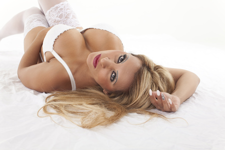girl boobs: blonde woman in underwear on white