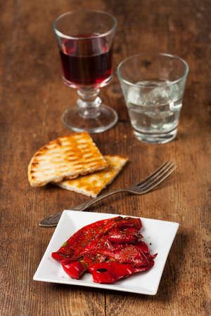 starter: greek starter with wine on wood
