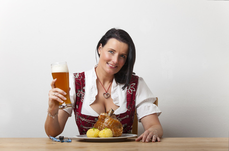 knuckle: bavarian woman with roasted knuckle of pork