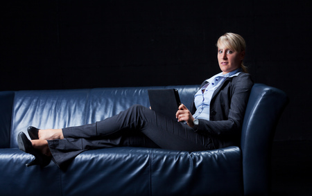 woman on couch: business woman on a couch Stock Photo