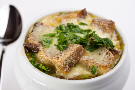 scalloped: onion soup scalloped with cheese in a soup pot Stock Photo