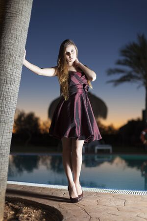 evening gown: woman in a evening gown at the pool
