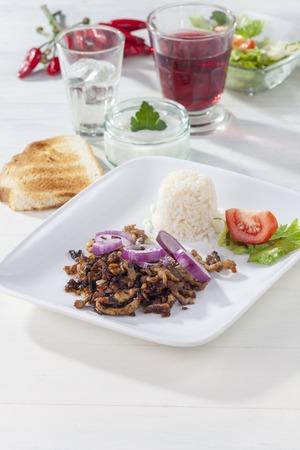 gyros: greek gyros on a white plate