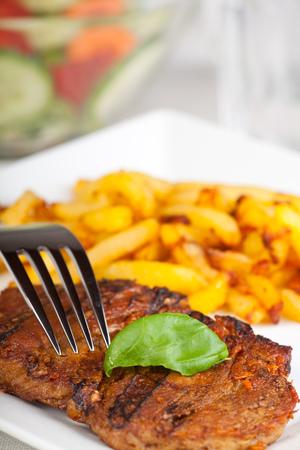 juicy: juicy pork steak with french fries