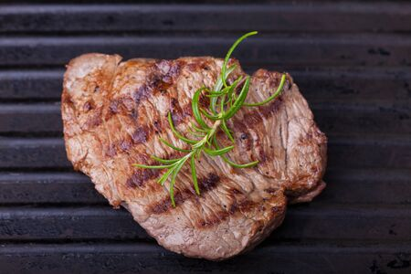 beefsteaks: steak in a pan with rosemary