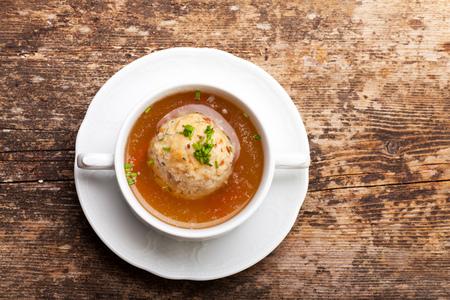 farce: speckknoedel, a tyrolean dumpling in broth