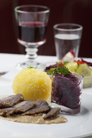 speciality: bavarian sauerbraten, a marinated beef speciality Stock Photo