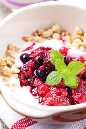 bee balm: closeup of breakfast cereals with fruits and yoghurt
