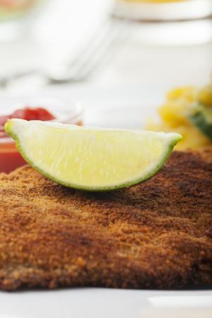 schnitzel: closeup of a lemon on a schnitzel