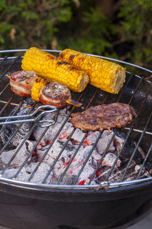 meat and corn on the grill Stock Photo