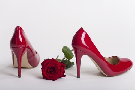 red high heels on white background