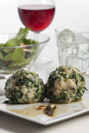 italian spinach dumplings with sage Stock Photo
