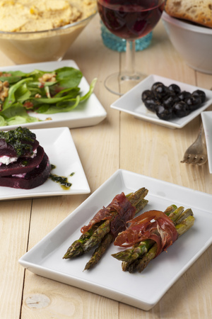 mixed antipasti on a wooden table