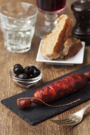 spanish chorizo sausage on black slate  Stock Photo
