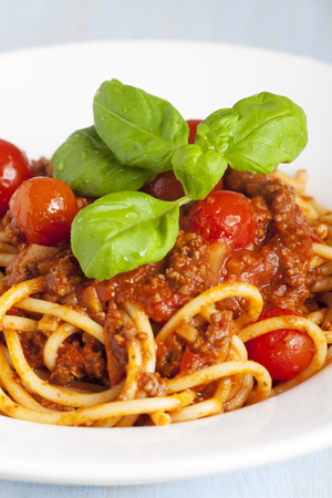portion of spaghetti bolognese on a plate Stock Photo