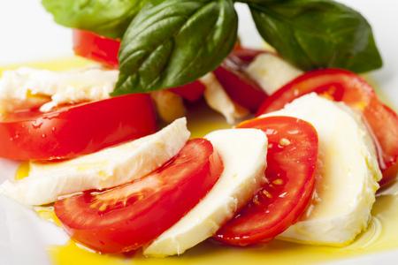 mozarella, basil and tomatoes Stock Photo