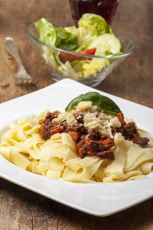 portion of tagliattelli with sauce bolognese