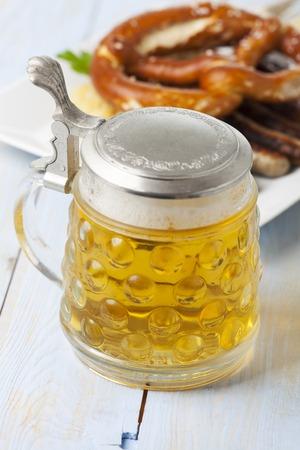 beer in a mug and nuremberg bratwurst