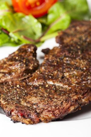 closeup of a steak with pepper
