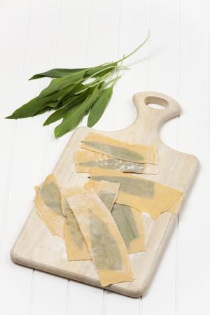 fresh wild garlic pasta with fork Stock Photo