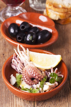 Spanish octopus tapa with olives