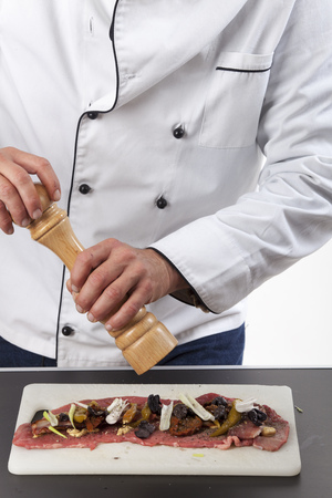 chef preparing a meat roulade Stock Photo