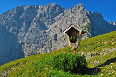 cross in the karwendel alps