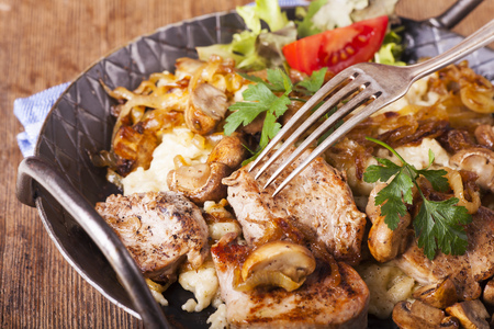pork fillet on spaetzle with mushrooms  Stock Photo
