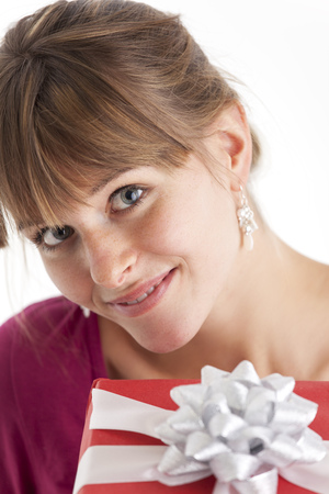 smiling woman with a gift on white