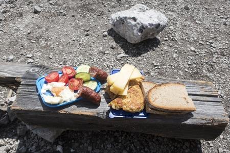 mountaineers snack on wood  Stock Photo