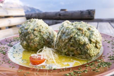 austrian spinach dumplings on a table  Stock Photo