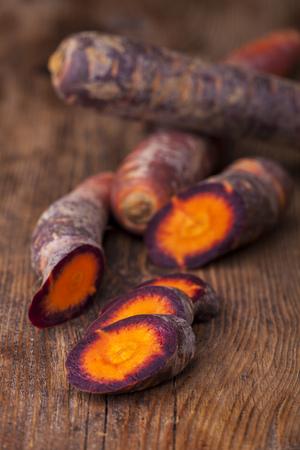 sliced carrot on dark wood