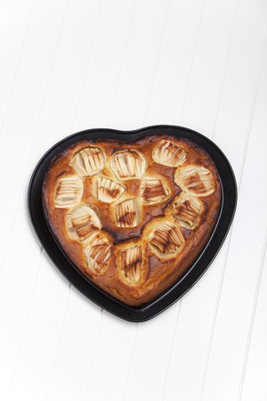 heart shaped apple pie on white  Stock Photo